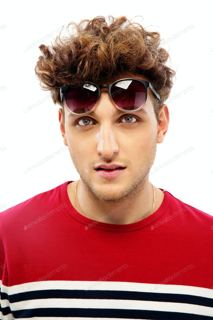 Portrait of a fashion young man with sunglasses over white background