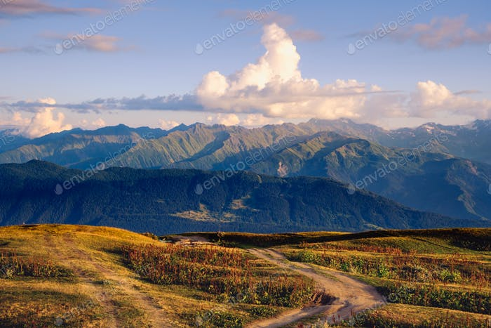 Mountain range landscape view with with beautiful sunset clouds, Svaneti, Georgia