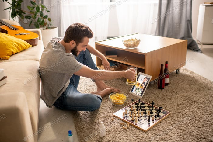 Drinking beer and playing chess