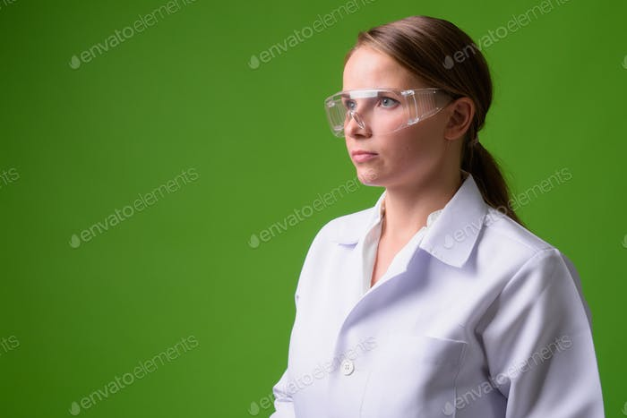 Young beautiful blonde woman doctor wearing protective glasses