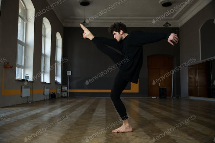 Full length portrait of a man dancing at gym