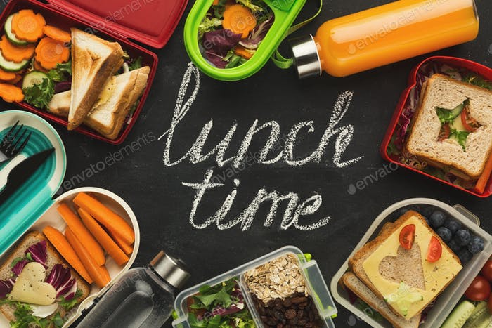 Lunch boxes filled with healthy food on black board