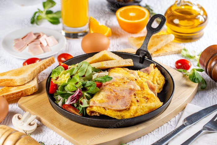 Omelet with ham and salad