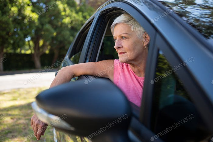 Senior woman sitting in a car