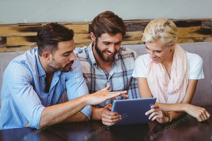 Business team looking at tablet in the cafe