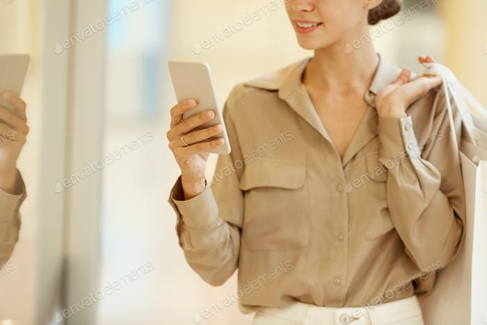 Shopaholic with mobile phone