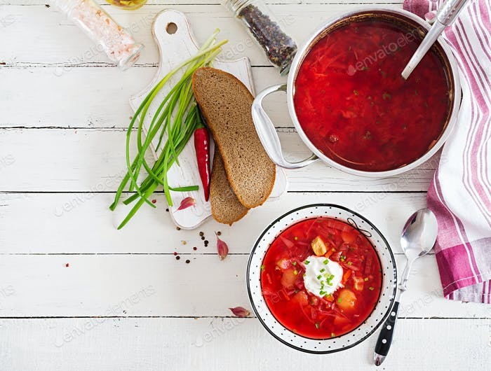 Traditional Ukrainian Russian borscht with white beans on the bowl. Beetroot soup.
