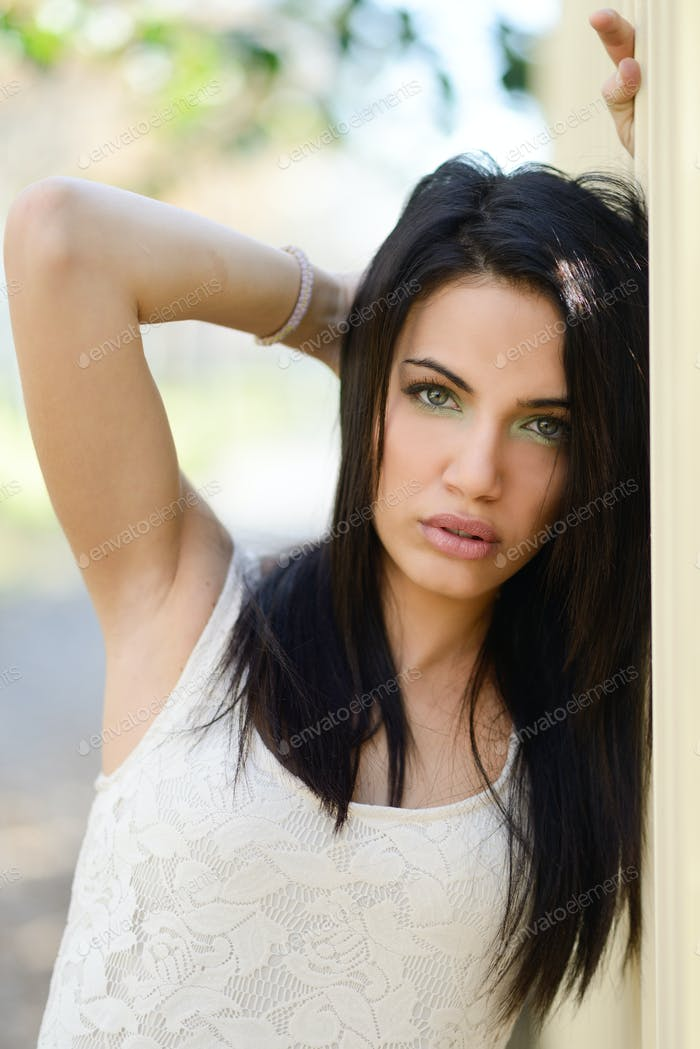 Young woman with green eyes in urban background