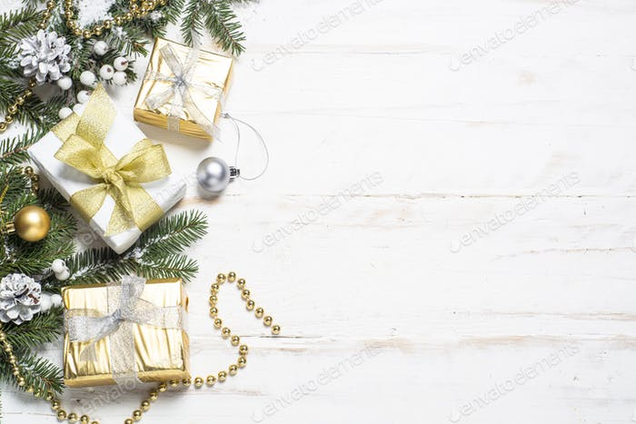 Christmas background with gold and silver decorations on white