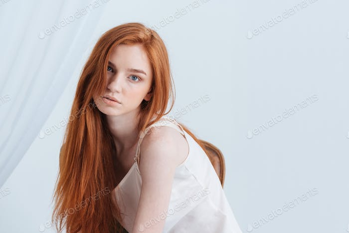 Portrait of a charming redhead woman looking at camera