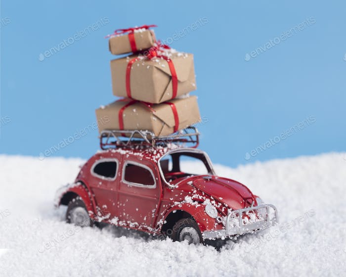 Close up of retro red car with Christmas and New Year presents