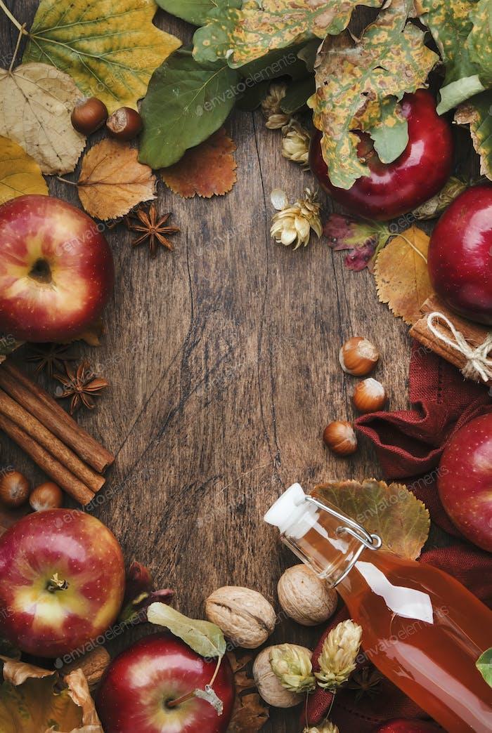 Apple cider vinegar. Bottle of fresh apple organic vinegar on wooden table background