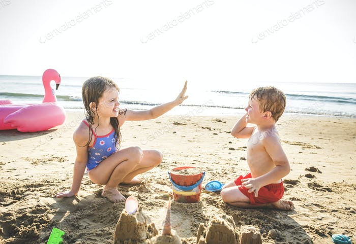 Siblings having fun on the beach