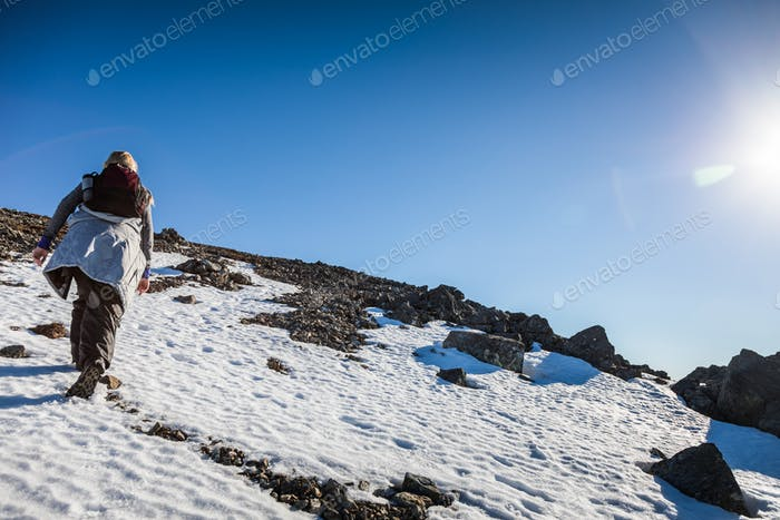 Woman Reaching the Top of Richardson Mountain in National Park o