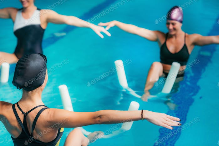 Aqua Aerobic Training with Water Fitness Equipment.