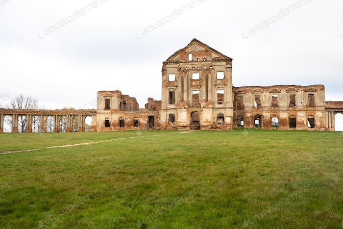 Ruzhansky Palace and the ruins of the facade of an abandoned ruined building of an ancient castle of