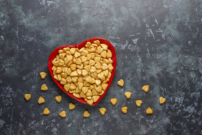 Heart shaped crackers in a heart shaped bowl.