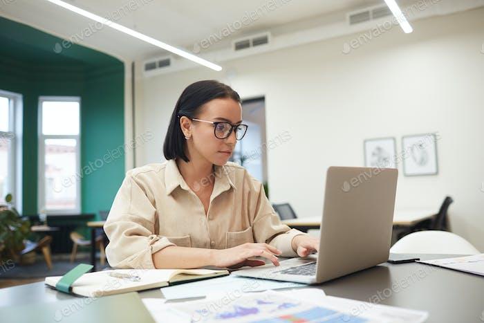Woman has online work on laptop