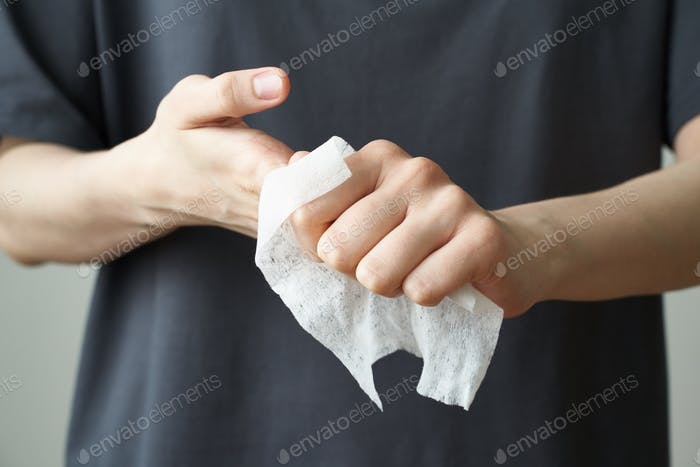 Woman wash hand wet wipes, to prevent illness Novel coronavirus (2019-nCoV) after public place