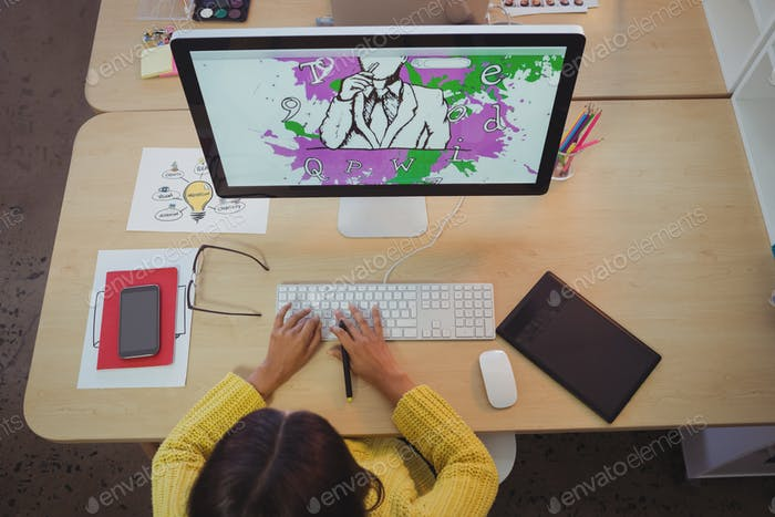 Female graphic designer working in creative office