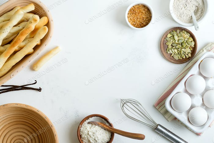 Natural organic ingredients for baking homemade traditional bread or cakes on a light grey marble