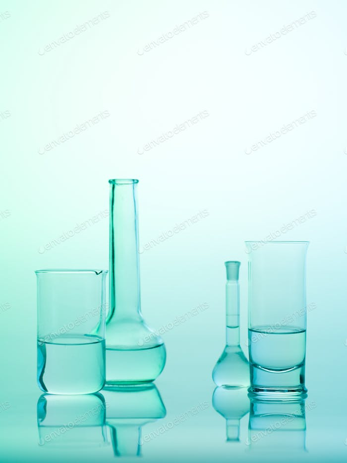 laboratory glass utensils on blue background