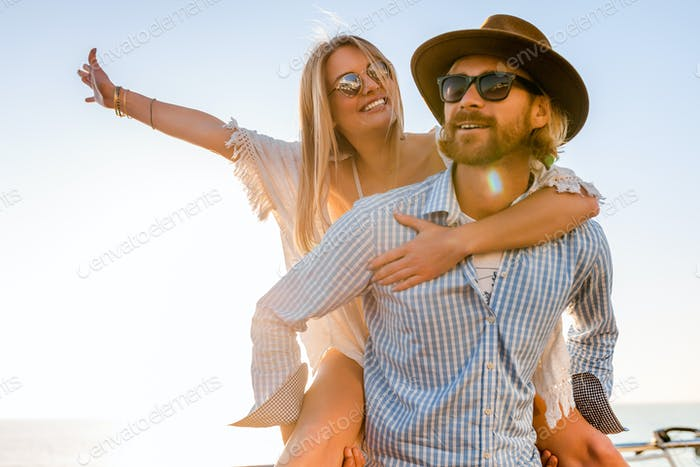 woman and man in love traveling sunset sea