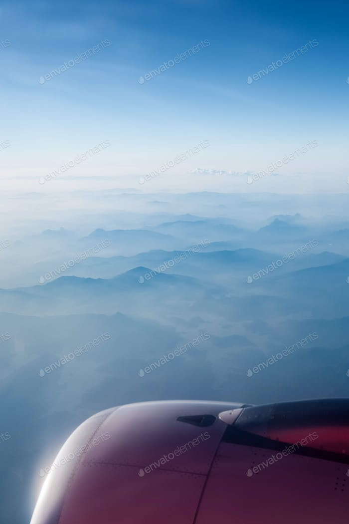 aircraft engine above the mountain ranges