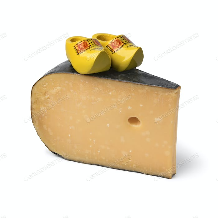 Mature Dutch Gouda cheese with wooden shoes