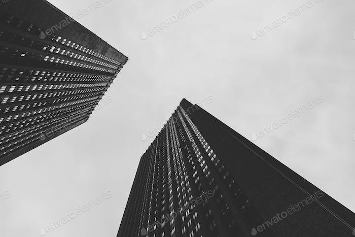 Low angle view of skyscrapers. Black and white photography.
