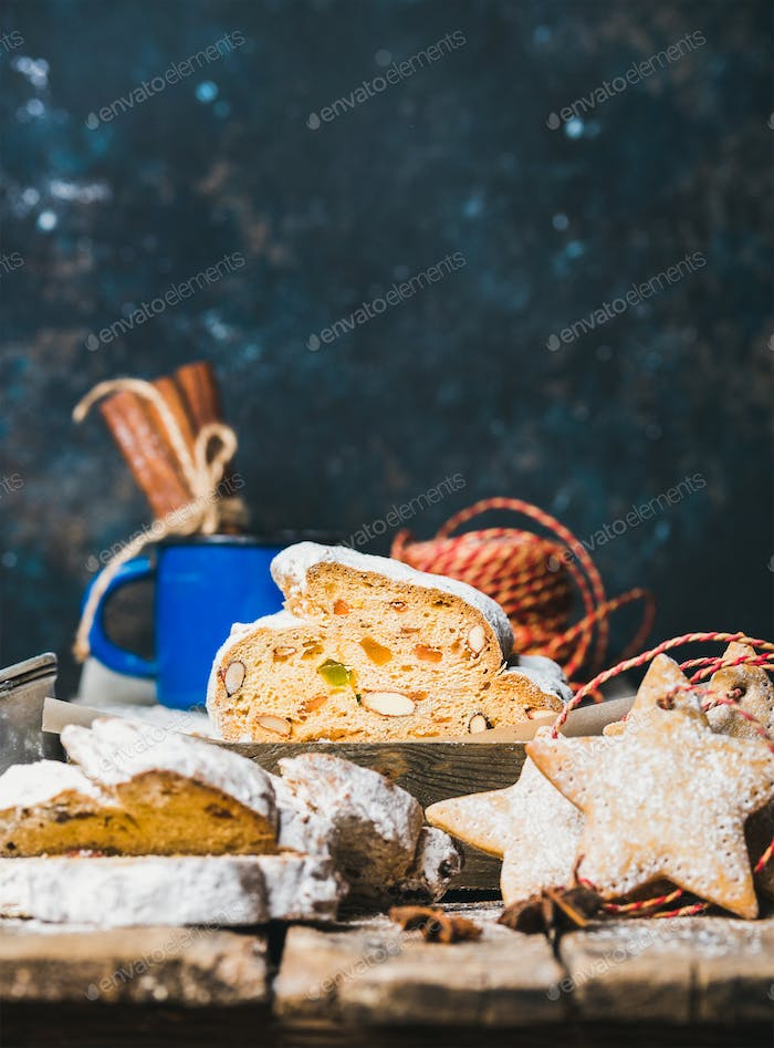 Traditional German Christmas cake Stollen with gingerbread cookies, copy space