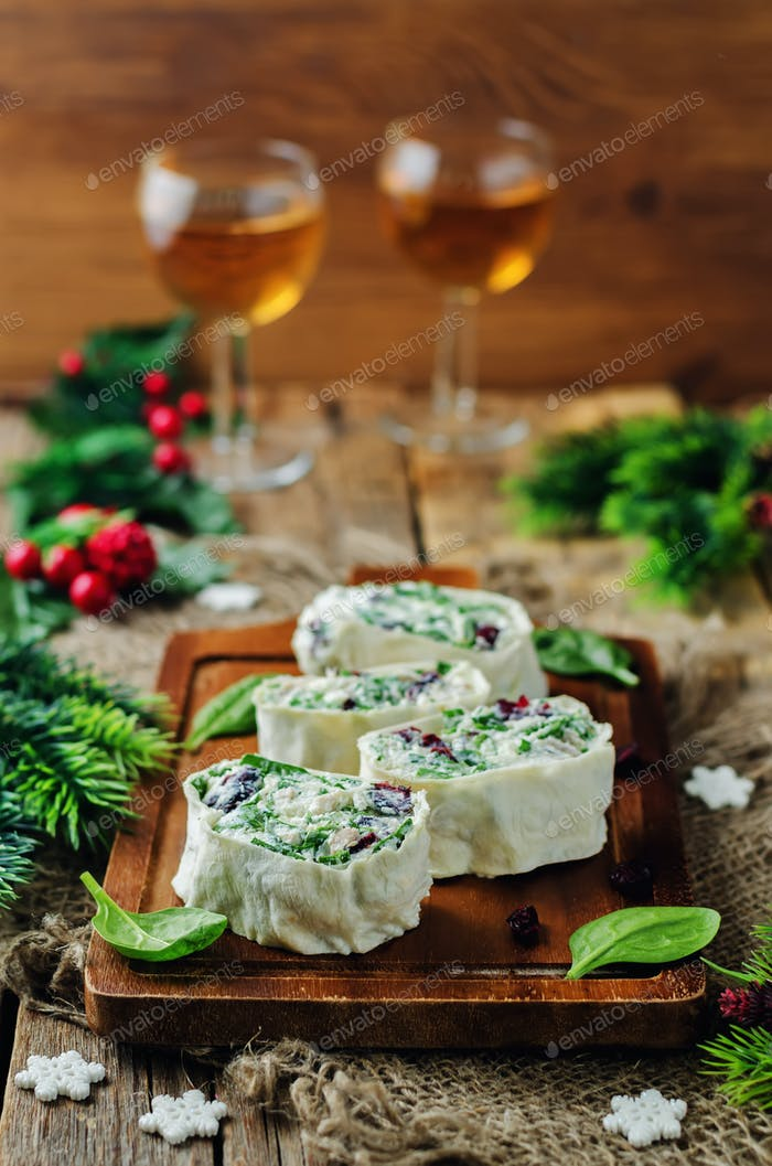 Turkey spinach ricotta dried cranberry roll ups