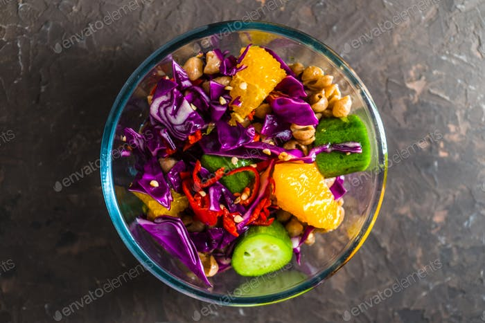 Salad of vegetables and fruits in a glass bowl