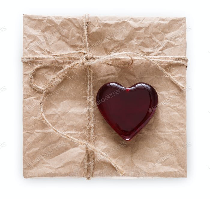Valentine day handmade present old paper with red heart isolated on white background