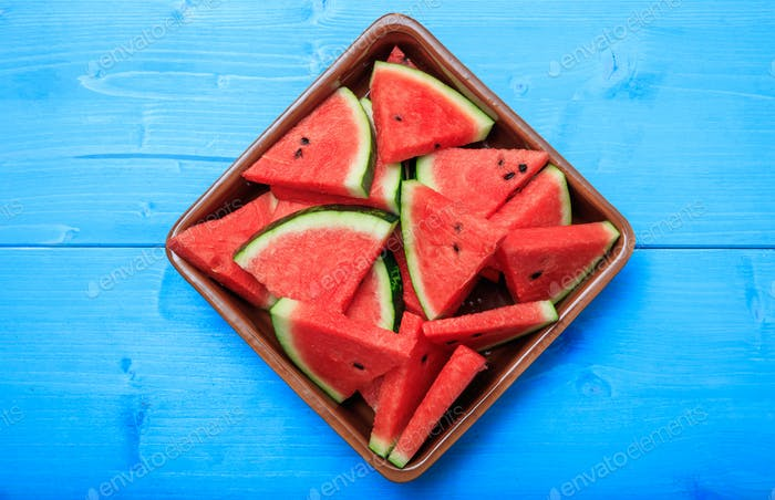 Watermelon pieces on a blue table