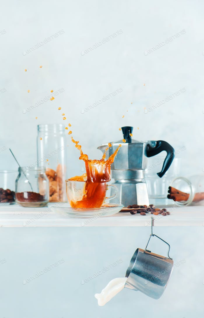 Kitchen shelf with Moke pot, a cup of espresso with a dynamic splash, milk pitcher and a jar of