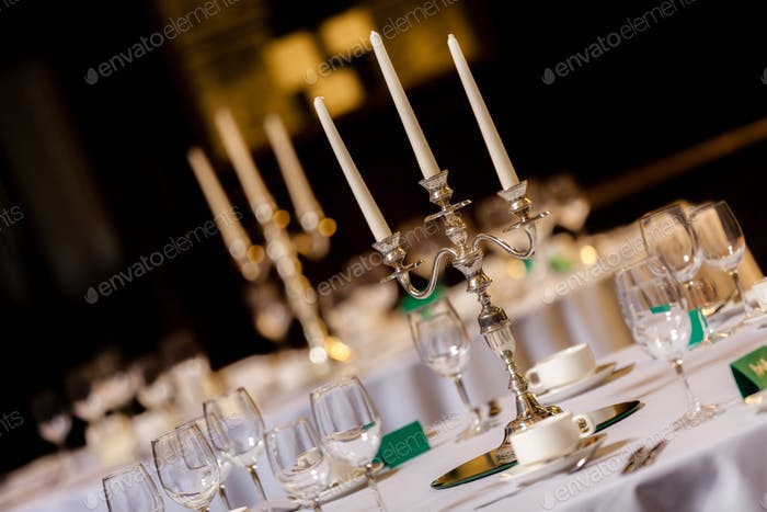 Wedding candlesticks on a wedding table