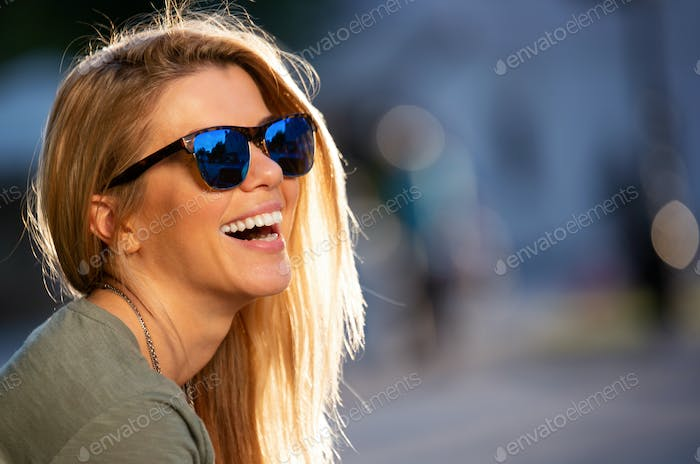 Happiness concept. Happy woman having fun on city street