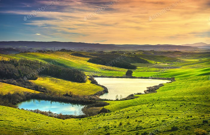 Tuscany, small lakes and rural landscape on sunset, Siena Italy.