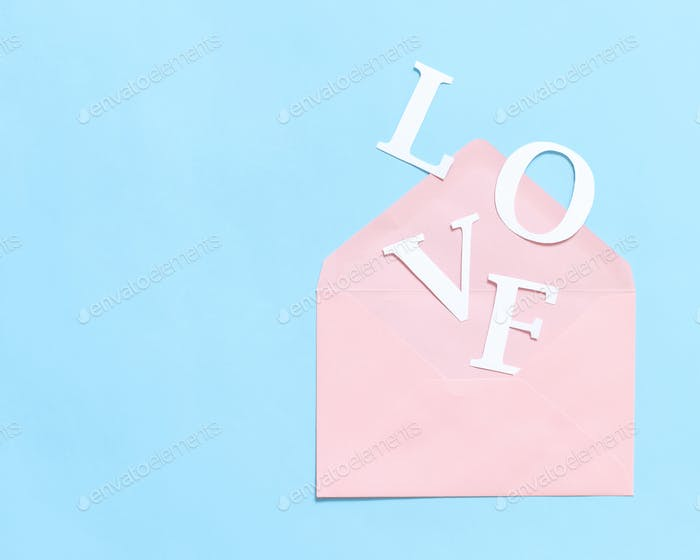 Word LOVE and pink envelope on a light blue background