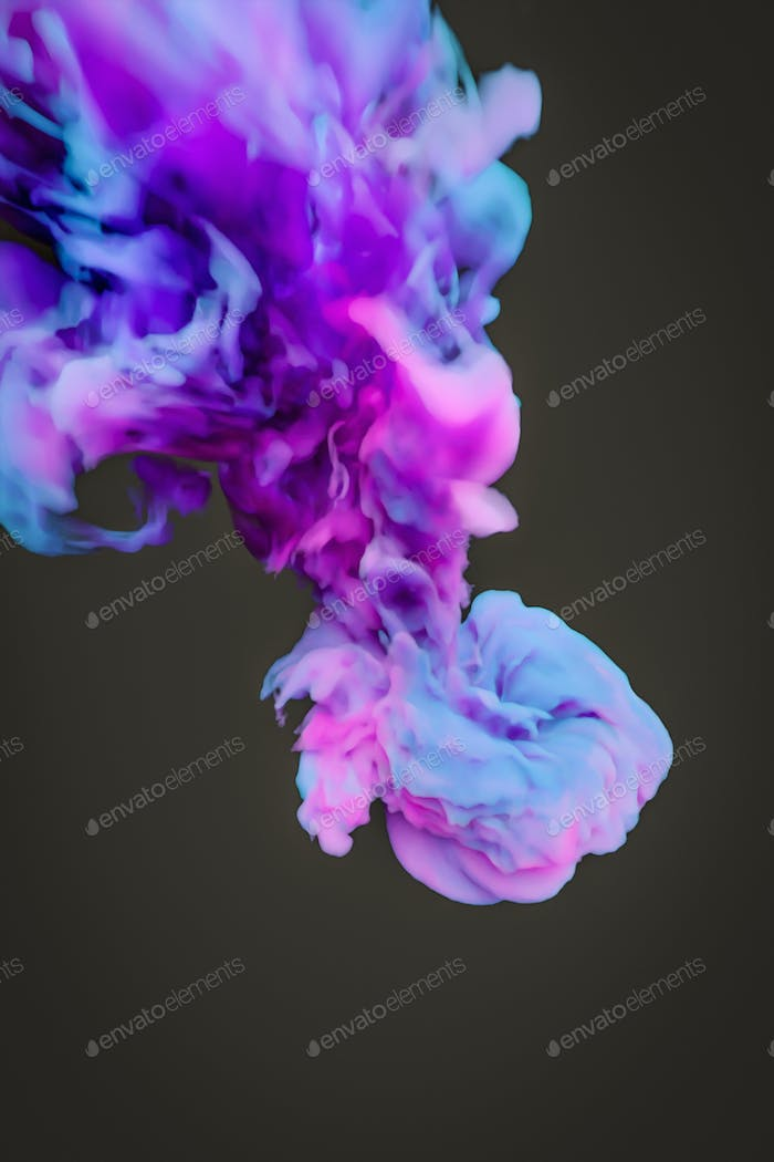 a colorful blue pink ink splash in water