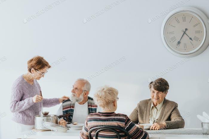 Senior people eating together