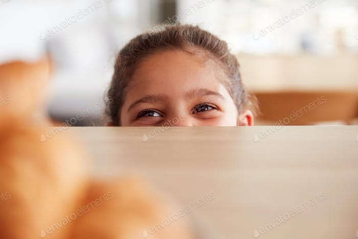 Mischievous Girl Wearing School Uniform Taking Croissant From Kitchen Counter