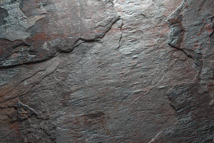Hintergrund grau mit braunem Stein