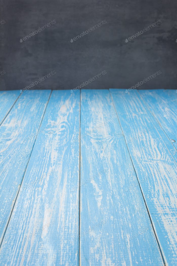 empty blue wooden table in front