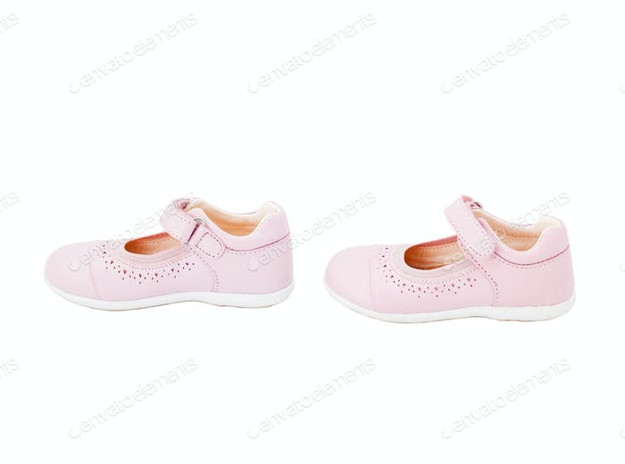 Pink leather baby shoes.