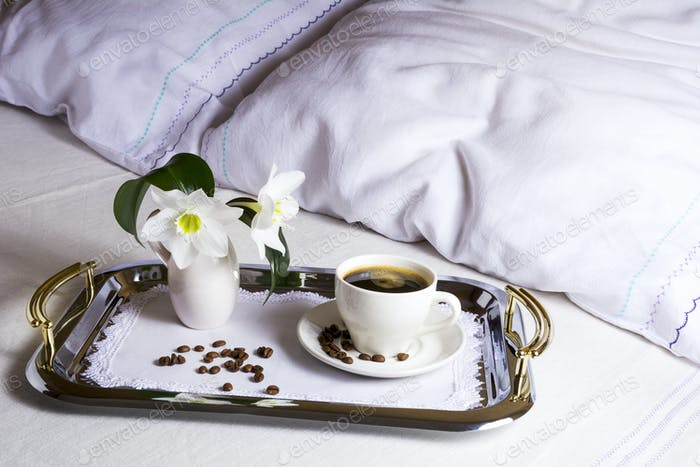 Morning coffee in bed on elegant silver tray