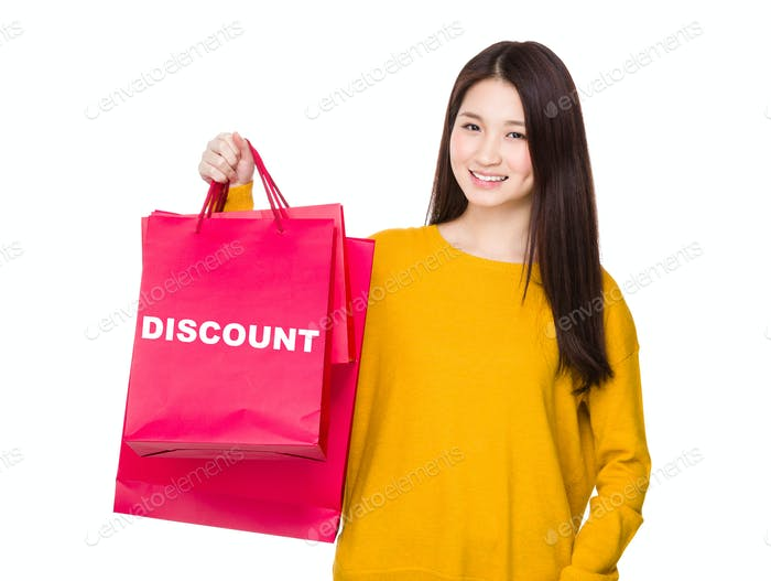 Woman hold with red shopping bag showing a word discount
