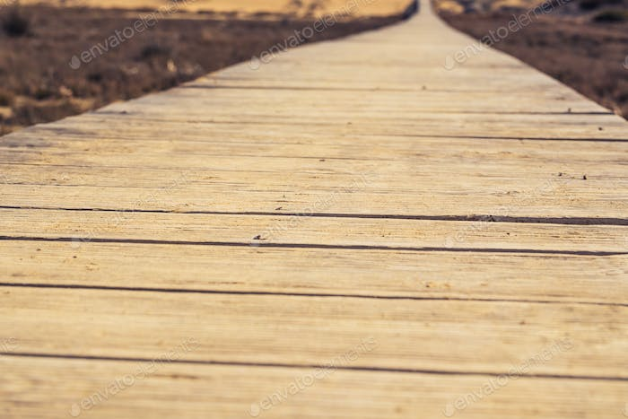 Close-up of wooden beach boardwalk path