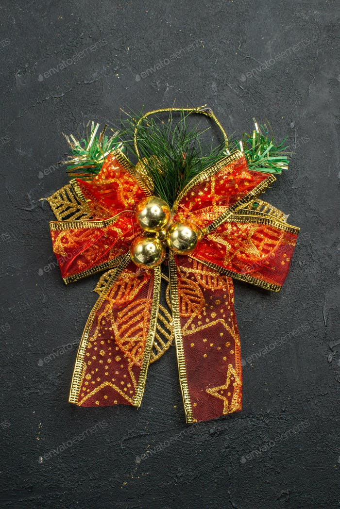 top view xmas tulle bow on dark background